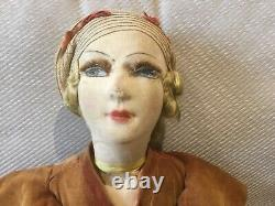 1920s antique Boudoir doll with porcelain limbs, silk dress, wood wool stuffed