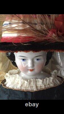 Antique China Doll Early 23 C. 1850-1880s China arms and feet/boots