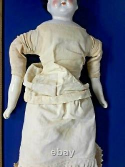 Antique German China Head Doll with porcelain arms, dress, boots