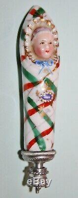 Antique german porcelain swaddling baby as perfume bottle /needle case c1850s