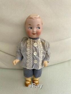 Antique porcelain head doll Gebrüder Heubach Googly Googlie