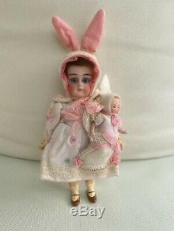 Antique porcelain head doll K & R Bunny mom with Baby