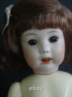 BLEUETTE Reproduction porcelain doll. Mold SFBJ251 Brown eyes FRANCE