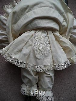 French Bébé Reproduction porcelain doll originally made by Andre Thuillier