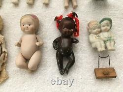 Lot of Antique small baby doll vintage bisque porcelain varied painted